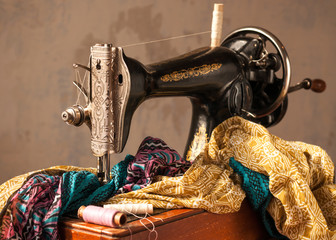 Old sewing machine, fabric and sewing thread.
