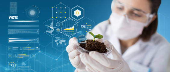scientist with plant and soil over virtual charts