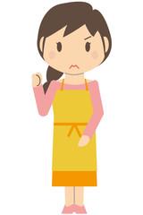 かわいいロングヘアの主婦 小さく片手でガッツポーズ