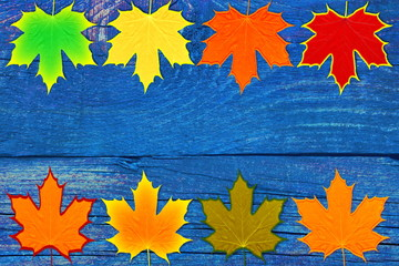 old rustic vintage grunge wooden background with colorful fall leaves