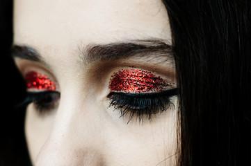 Glittering red make up black eyeliner