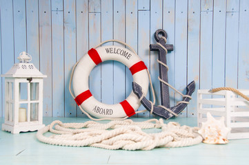 Decor in the style of sea travel. Anchor and lifebuoy, lantern