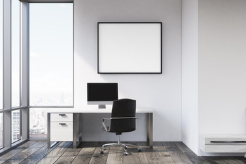 Gray wall workplace with poster