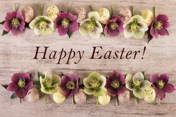 Easter background Happy Easter. Spring Flowers arrangement on light brown rustic background