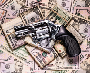 stack of cash with revolver