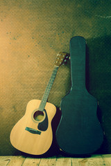acoustic guitar with hard case on old steel background