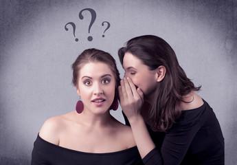 girl telling secret things to her girlfriend