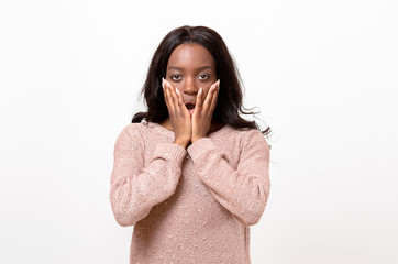 Shocked young African woman