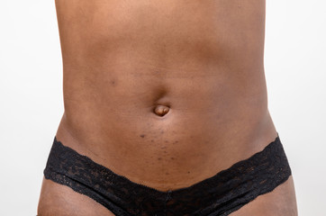 Abdomen of a slim toned young woman