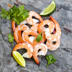 Shrimps on Slate Top View with Lime and Cilantro