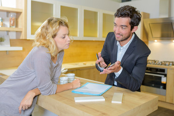Woman in discussion with salesman