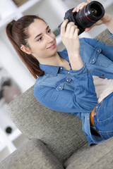 portrait of cute young teen with her photo camera
