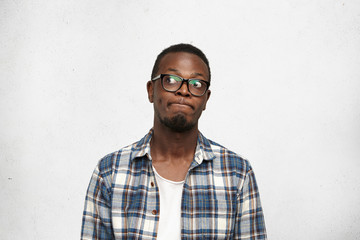I don't know. Clueless funny young dark-skinned male wea