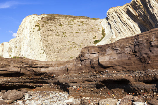 Anthropocene. Industrial sediments layer in cemented beach