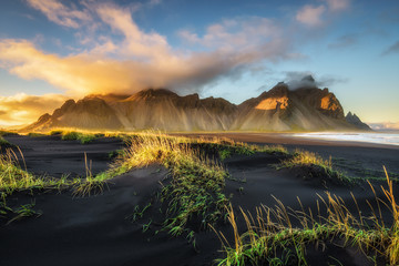 Wall Mural - Sunset above  Vestrahorn and its black sand beach in Iceland