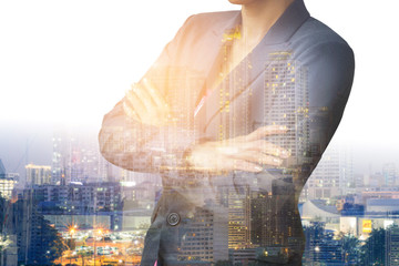 businesswoman. Double exposure, city on the background. Blurred background,