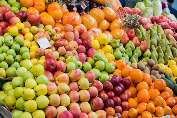 A wide variety of fruits in trays on the market.