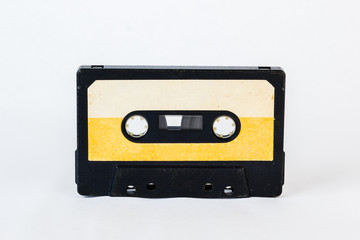 Old audio cassette isolated on white background. Historical records sound on a magnetic tape. Place for your text.