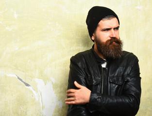 Bearded brutal caucasian hipster smoking cigar