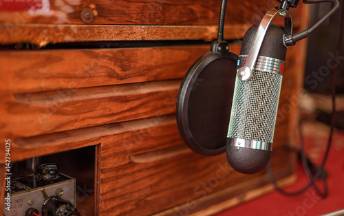 spinning kitchen cabinet quot a silver ribbon microphone with pop filter placed on a 2428