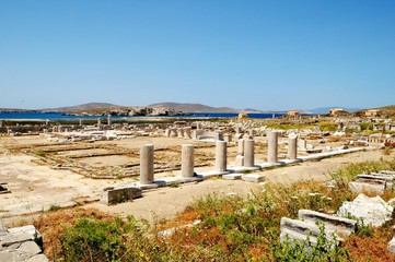 Ruins Of Delos, Greece/Remains of antique marble Collonade. Architecture Of Ancient Greece, it`s one of  largest museums of Antiquity under the open sky