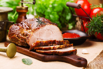 Roast pork with tomato dip and herbs.