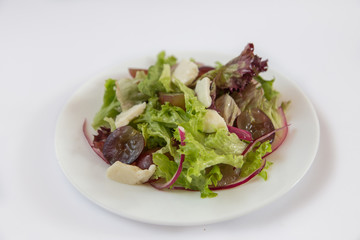 Dietary salad., Grapes, cheese, onions Lettuce. Plate isolated on white background
