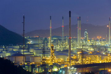 Refinery aerial view at twilight, industrial landscape background