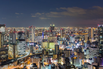 Osaka city downtown aerial view at night from Umeda Sky building