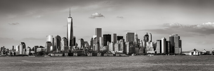 Lower Manhattan with the Financial District skyscrapers and Ellis Island. Panoramic view of New York City. Black & White