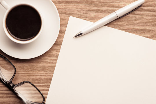 Blank Paper Note on Tablet with Pen. Business Plan Concept