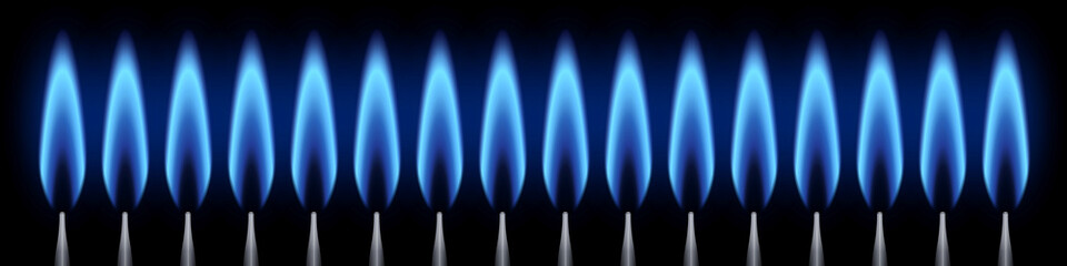 Brûleurs allumés. Flamme bleue. Fond noir