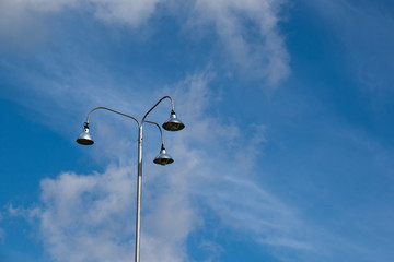 outdoor lamppost on the street with a clear blue sky background.