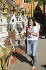 Asian thai people and foreigner people respect praying and walk visit chedi at Wat Phra That Lampang Luang