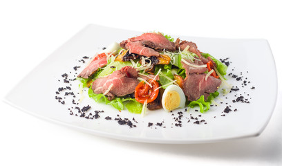 meat salad with roast beef, mushrooms, vegetables and cheese on white background, isolated