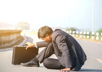 failed architect sits on the floor.The business man fail.