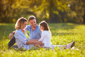 Mother and father with daughter outdoor