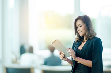 Beautiful asian businesswoman using tablet in office