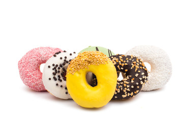 Donuts in color glaze isolated