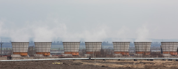Smoking industrial chimneys.Heating pipes