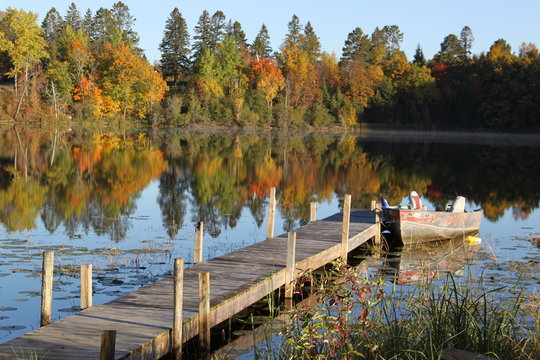 fishing boat and dock on Minnesota lake