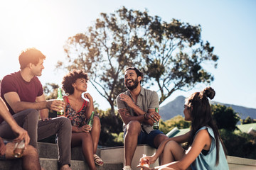 Multiracial young people partying outdoors
