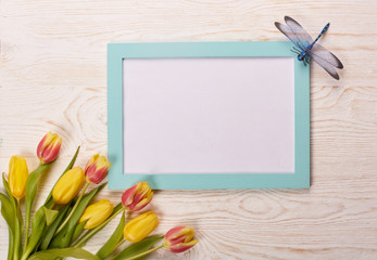 Blank sheet and tulips.