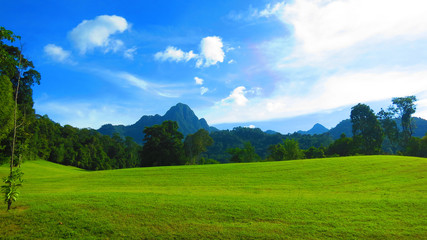 Beautiful golf course on the tropical Langkawi islands of Malaysia, with Mountains in the background