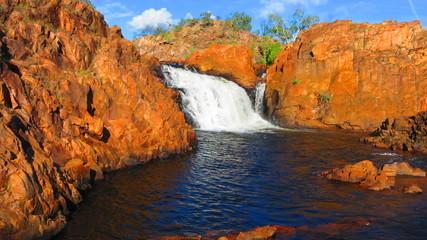 Beautiful Edith Falls waterfall with red rocks in the Northern Territory NT, Australia near Pine Creek