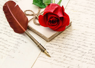 Red rose flower old letters antique feather pen