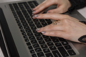 Hands of the girl on the keyboard