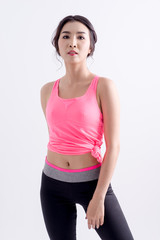 asian woman in pink sports bra with white background