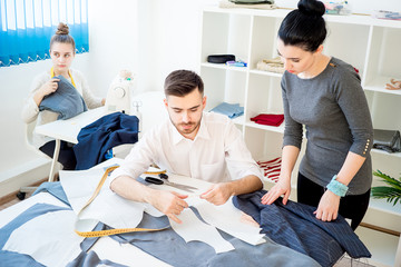 Tailors working on clothes