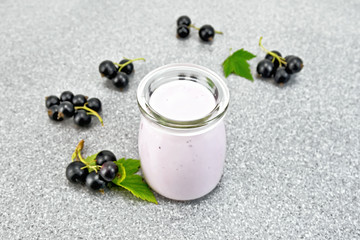 Milk cocktail with black currant on stone table